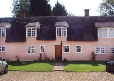 Thatched & rendered listed property decoration